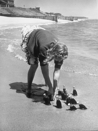 Summer at Cape Cod: Bottles of Coca Cola Buried in the Surf to Keep Them Cool Photographic Print by Alfred Eisenstaedt