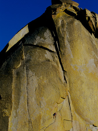 A Rock Climber Climbs a Rock Face Without the Aid of Hooks or Ropes in Needles, California Photographic Print by Barry Tessman