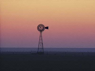 A Windmill Breaks the Flat Horizon of the Texas Panhandle at Dawn Photographic Print by George F. Mobley