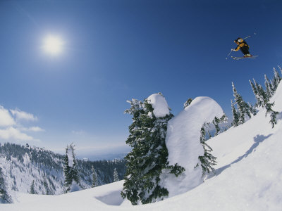 A Skier Catches Some Big Air on the Big Mountain Photographic Print by Bobby Model