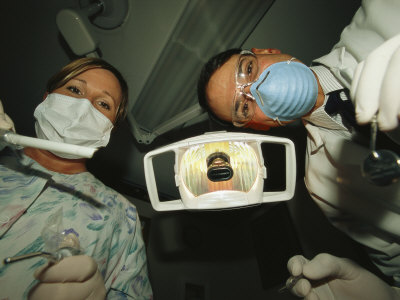 A Dentist and Dental Hygienist Prepare for an Examination Photographic Print by Joel Sartore