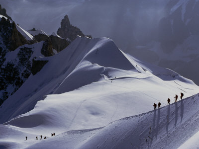 Hikers Follow a Path Across a Snow Field in the French Alps Photographic Print by Paul Chesley