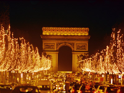 A Night View of the Arc De Triomphe and the Champs Elysees Lit up for Christmas Lmina fotogrfica