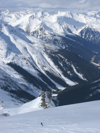 A Back-Country Snowboarder Descends a Snowfield Near Rogers Pass Photographic Print by Skip Brown