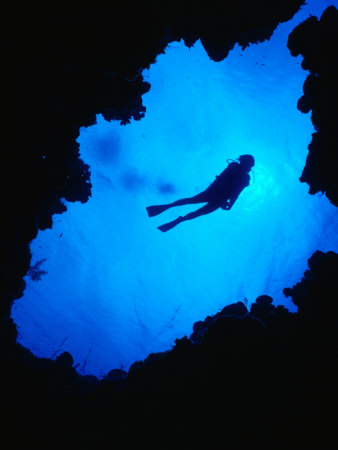 Diving off Limestone Platform into Blue Hole at Bat Cave, Gene's Bay, Bahamas Photographic Print by Michael Lawrence