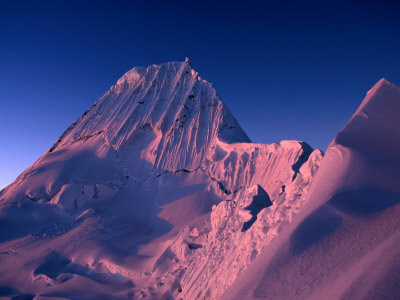 Sunset on Southwest Face of Nevado Alpamayo, Cordillera Blanca, Ancash, Peru Photographic Print by Grant Dixon