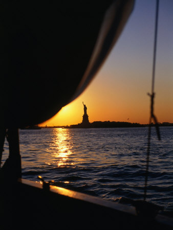 Statue of Liberty at Sunset from Staten Island Ferry, New York City, New York, USA Photographic Print by Angus Oborn