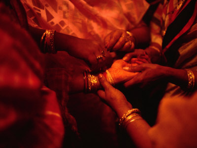 Hand of Bride Being Held by Female Relatives During Wedding Ceremony, India Photographic Print by Richard I'Anson
