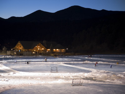 Ice Skating and Hockey on Evergreen Lake, Colorado, USA Photographic Print by Chuck Haney