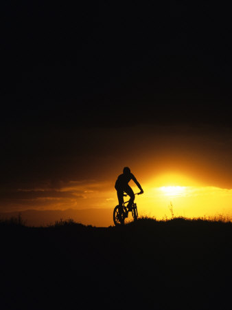 Mountain Biker Against Stormy Sunset, Fruita, Colorado, USA Photographic Print by Chuck Haney