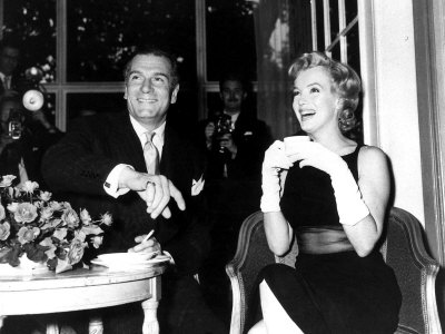 Marilyn Monroe Drinking a Cup of Tea as She Sits with Laurence Olivier Smoking a Cigarette, 1956 Photographic Print