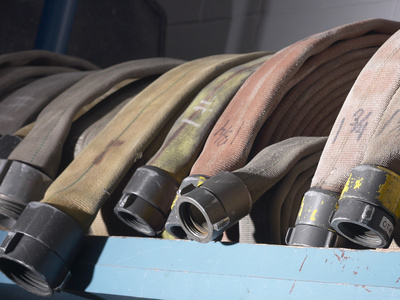 Row of Fire Hoses Photographic Print