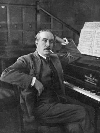 Giacomo Puccini Leans on the Pianoa Cigarette Dangling from the Side of His Mouth Photographic Print by G. Magrini