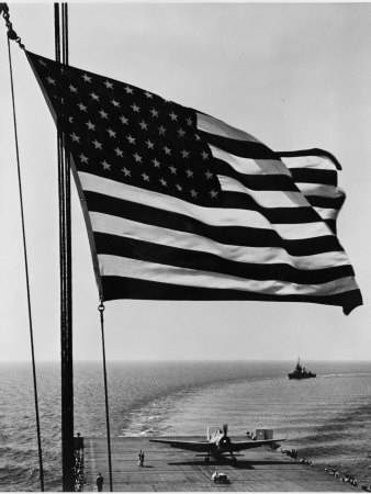 Airplane on Battleship Deck with American Flag in Foreground, World War II Premium Poster