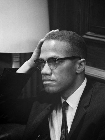 Malcolm X waits at Martin Luther King Press Conference, 1964 Premium Poster