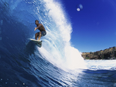 Wave Curling Up Over Surfer Photographic Print