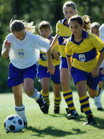 Group of Girls Playing Soccer Photographic Print