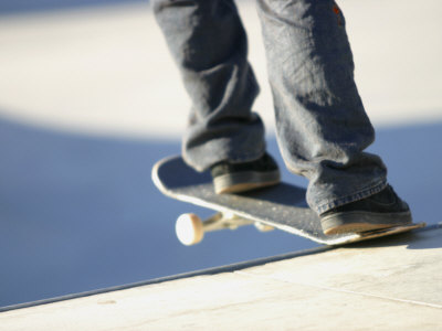 Feet on a Skateboard at the Edge of a Ramp Photographic Print