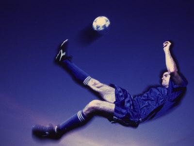 Soccer Player Kicking a Ball Photographic Print