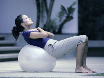 Side Profile of a Young Woman Exercising on a Fitness Ball Photographic Print