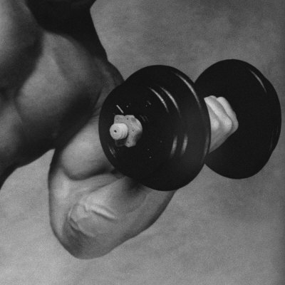 Close-up of a Man Lifting a Dumbbell Photographic Print