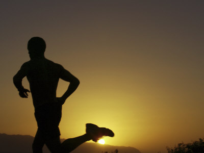 Silhouette of a Man Running Photographic Print