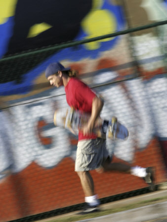 Young Man Running with Skateboard Photographic Print