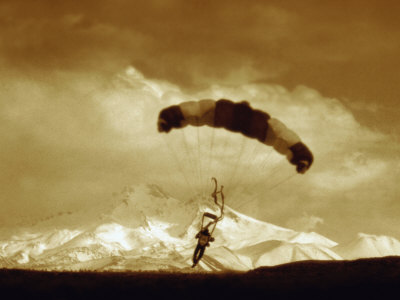 Parachutist with Mountain Background Fotoprint - bij AllPosters.be