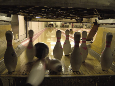 Rear View of Pins Being Struck by a Bowling Ball Photographic Print