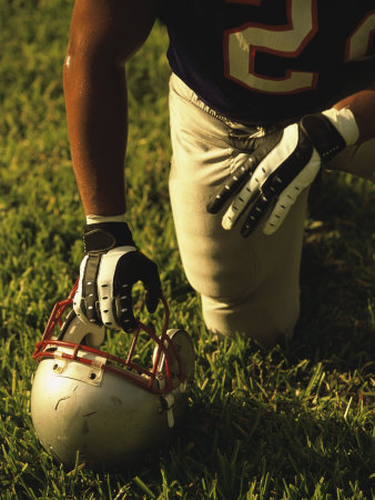 American Football Player Kneeling on the Field Photographic Print