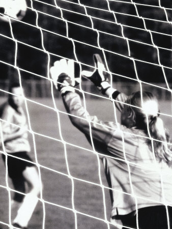 Female Goalie Attempting to Stop a Soccer Ball Photographic Print