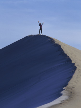 Woman Exercising on the Top of a Sand Dune Photographic Print
