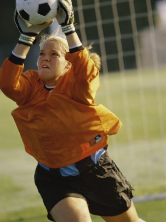 Female Soccer Goalie Catching the Ball Photographic Print