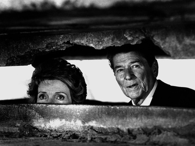 President Ronald Reagan and First Lady Nancy Reagan Peer out of a World War II Bunker Photographic Print