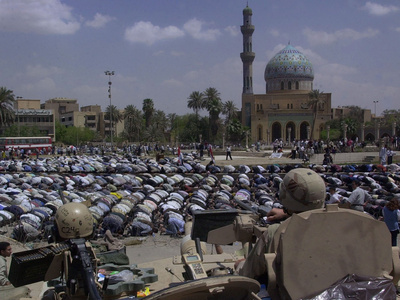 A Crowd of Iraqi Protesters Pray in Front of a U.S. Military Checkpoint Photographic Print