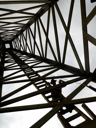 A Reenactor is Silhouetted Inside a Replica of the Spindletop Oil Derrick Photographic Print