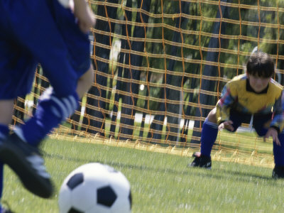 Goalie Attempting to Stop a Soccer Ball Photographic Print