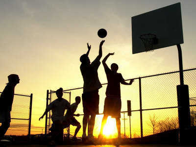 Students Play a Basketball Game as the Sun Sets at Bucks County Community College Photographic Print