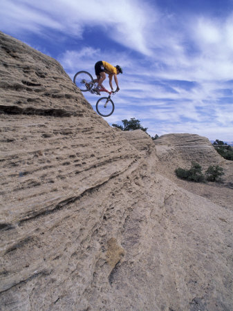 Active Male Rides Slickrock Ridge, Utah, USA Photographic Print by Howie Garber