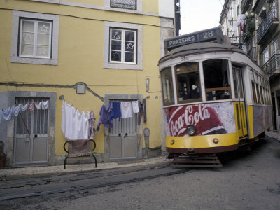 Cable Car in Narrow Streets, Lisbon, Portugal Photographic Print by Michele Molinari