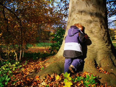 Boy Playing Hide-And-Seek in Frederiksberg, Copenhagen, Denmark Photographic Print by Martin Lladó
