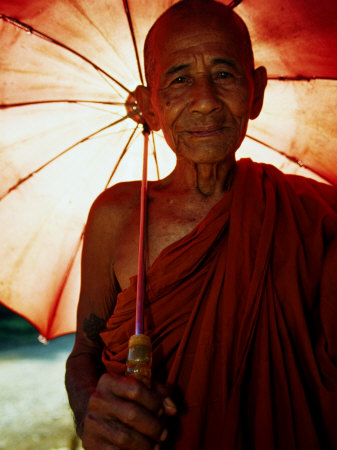Smiling Monk Holding Umbrella, Mrauk U, Myanmar (Burma) Photographic Print by Frank Carter