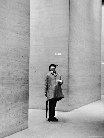 French Actor Jacques Tati Looking at the High Ceiling of an Office Lobby Premium Photographic Print by Yale Joel