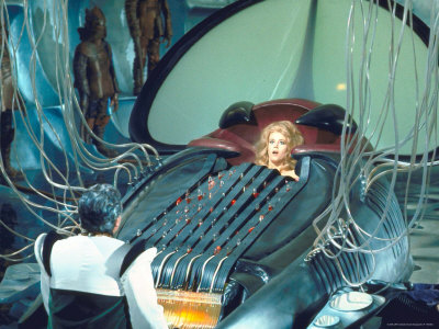 Actress Jane Fonda trapped in Machine which kills during scene from Roger Vadim's