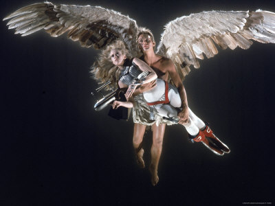 Actress Jane Fonda Being Carried by Guardian Angel in a Scene from Roger Vadim's Film