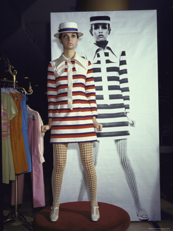 Model Dari Lallou Standing in Front of Poster of Twiggy Wearing Look a Like Outfit Metal Print by Ralph Crane