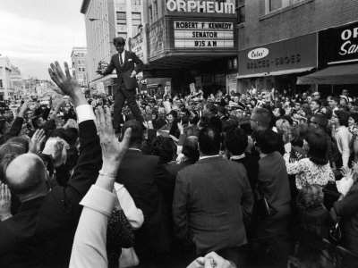 Sen. Robert Kennedy Standing on Roof of Car as He is Swamped by a Crowd of Welcoming Well Wishers Photographic Print by Bill Eppridge