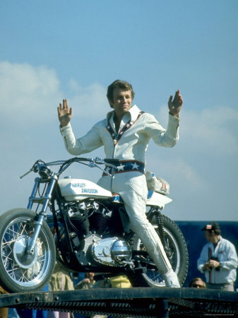 Motorcycle Daredevil Evel Knievel Poised on His Harley Davidson Metal Print by Ralph Crane