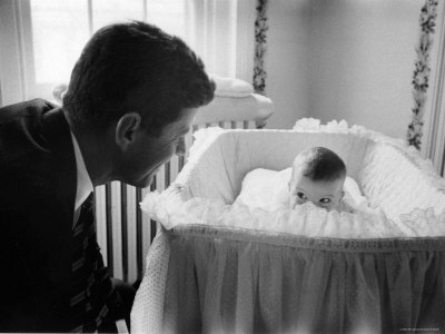 Sen. Jack Kennedy Admiring Baby Caroline as She Lies in Her Crib in Nursery at Georgetown Home Photographic Print by Ed Clark
