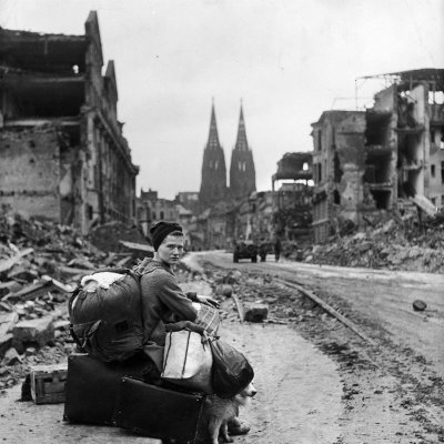 Homeless Refugee German Woman Sitting with All Her Worldly Possessions on Side of a Muddy Street Photographic Print by John Florea